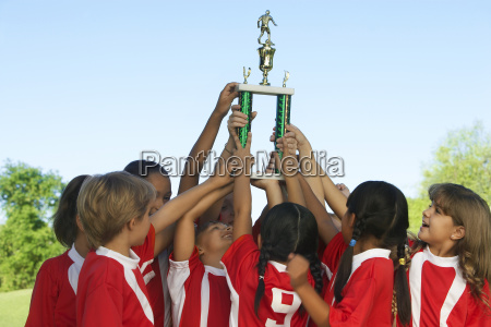 football team raising trophy