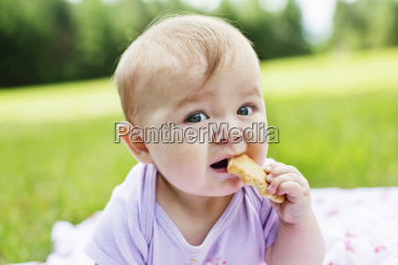 close up of infant girl eating