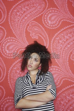 teenage girl against colorful wallpaper