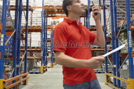 warehouse worker using walkie talkie