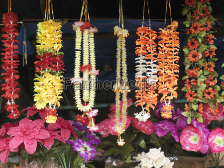 different necklaces and artificial flowers