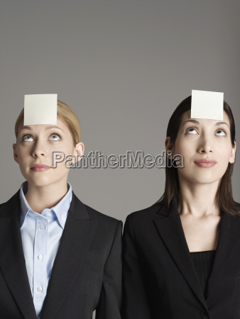 female office workers with sticky notes