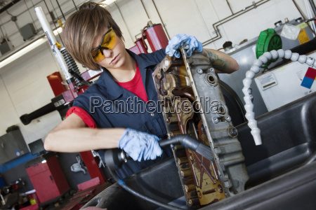 young female mechanic working with welding