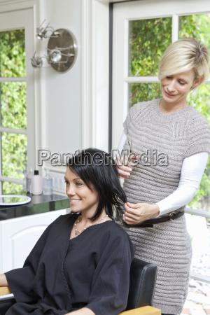 beautiful happy woman getting a haircut