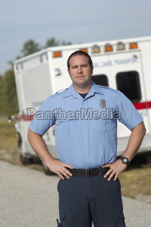 paramedic in front of ambulance