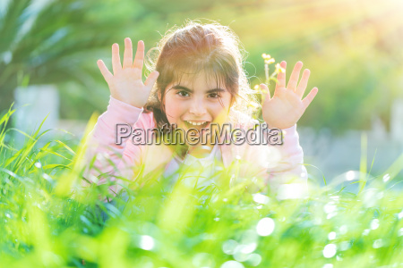 pretty child playing outdoors
