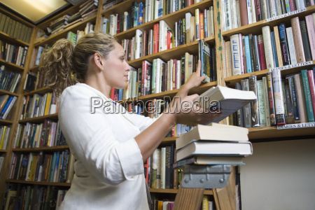 librarian arranging books at library