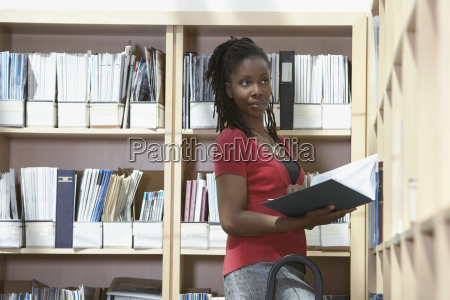 office worker on ladder in file