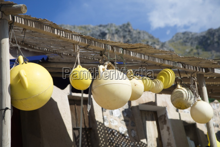 fishing floats hanging on porch