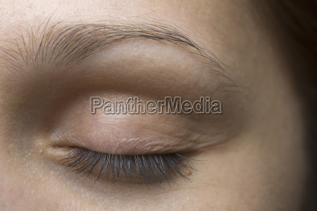 young womans closed eye