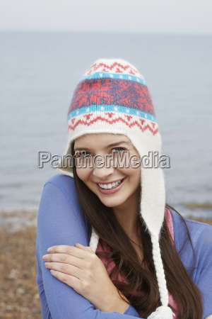 portrait of happy woman wearing knit