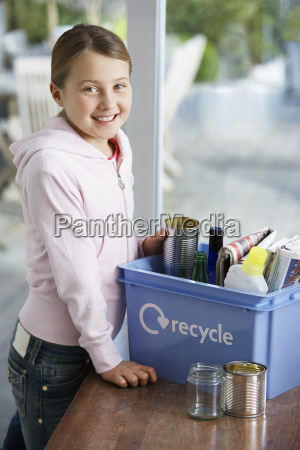girl putting empty vessels into recycling