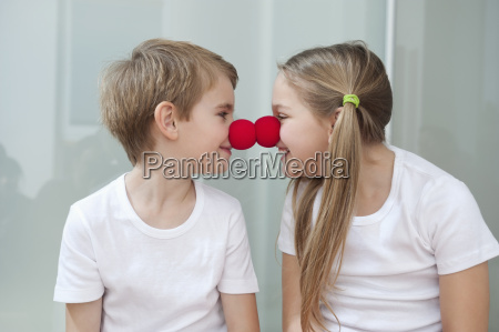 happy young siblings in white tshirts