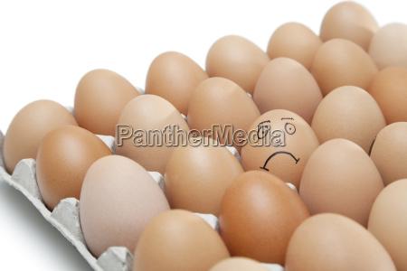 sad face drawn on an egg
