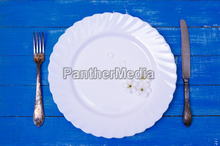 white empty plate and vintage iron