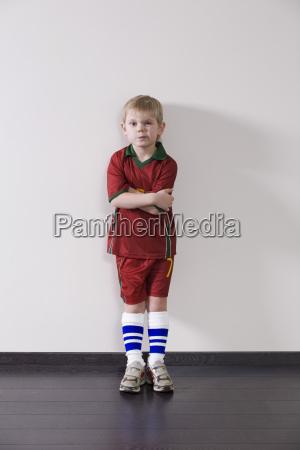 portrait of boy in sportswear against