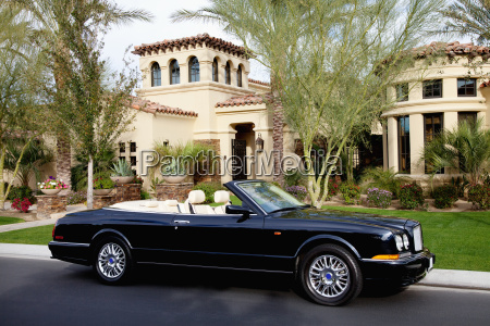 luxurious convertible car parked in front