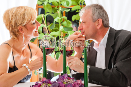 senior couple eating dinner in restaurant