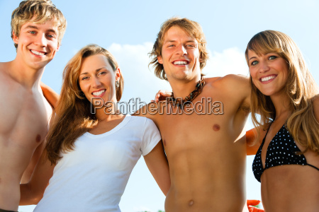 four young people on the beach