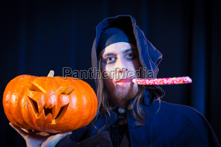 man in scary halloween costume holding