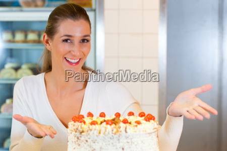 female baker or pastry chef with