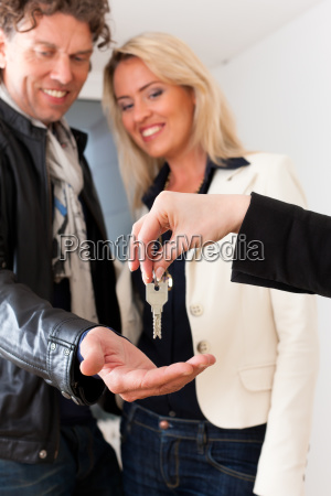 young realtor is with keys in