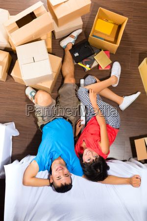asian couple moving in the new