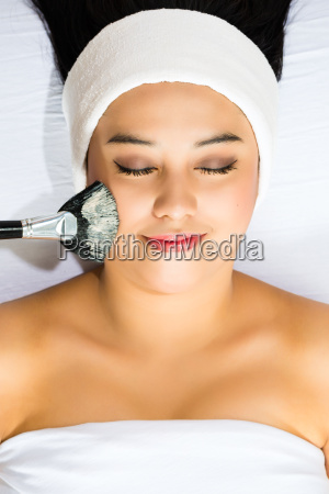cosmetics asian woman gets a
