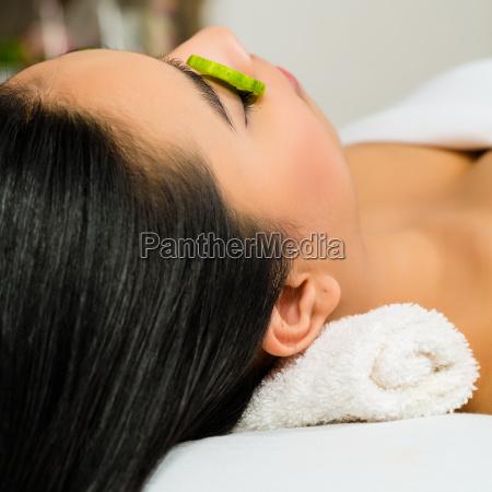 asian woman getting a facial treatment