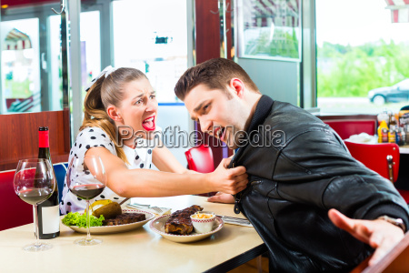 couple eating and drinking in fast