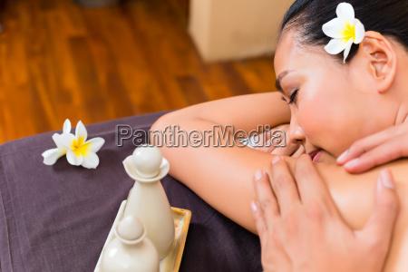 indonesian asian woman at wellness spa