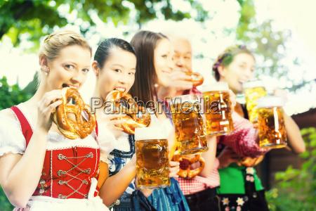 beer garden friends drinking in