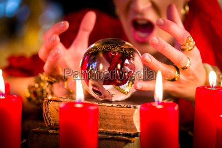 soothsayer during session with crystal ball