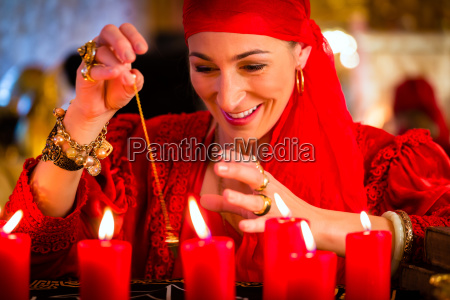 fortuneteller during pendulum session