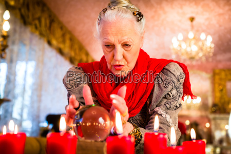 soothsayer during esoteric session with crystal