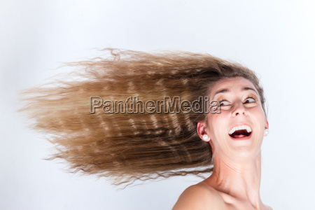 long hair of woman blowing in