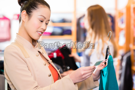 woman shopping clothes in fashion store