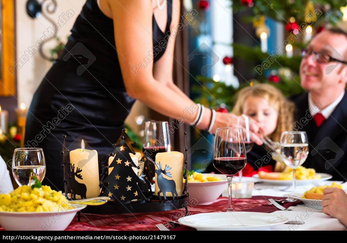 family, having, christmas, dinner, sausages - 21479167
