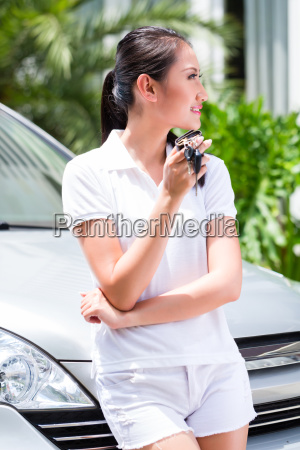 asian woman showing key of new