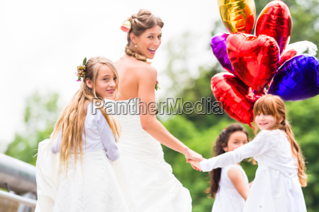 wedding bride in gown with bridesmaid