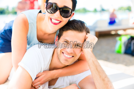 couple relaxing in summer sun on