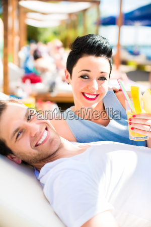 couple in beach bar relaxing with