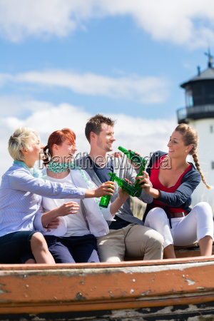 friends drinking bottled beer at beach