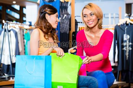 asian girl friend fashion shopping in