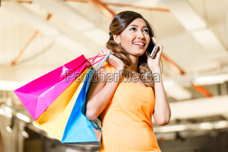 asian woman with phone shopping fashion