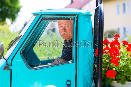 gardener delivering flowers with truck