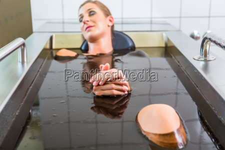 senior woman enjoying mud bath alternative