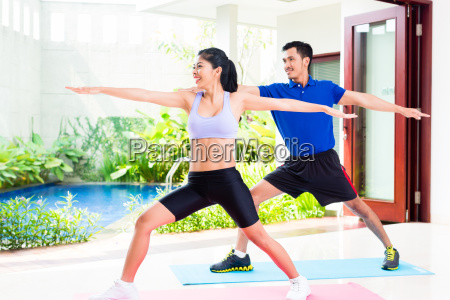 asian fitness couple at sport workout
