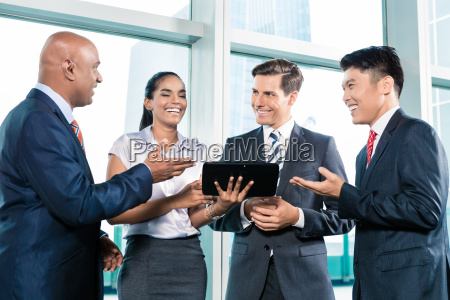 informal business people with table computer