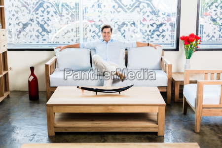 man sitting on couch in furniture